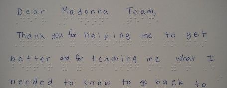 Young Kansan learns braille after traumatic brain injury